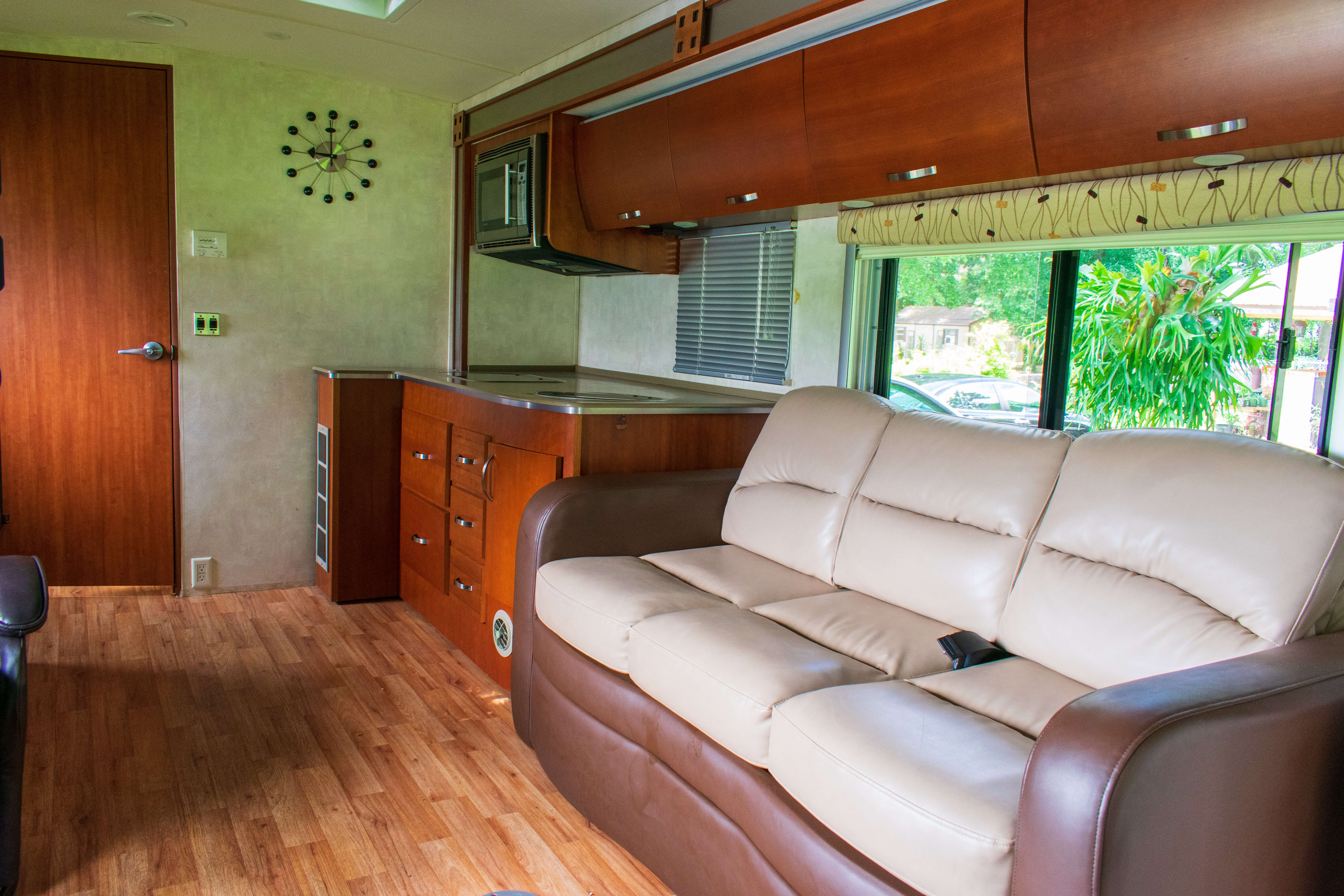 2010 Fleetwood Pulse 24S Living room and kitchen
