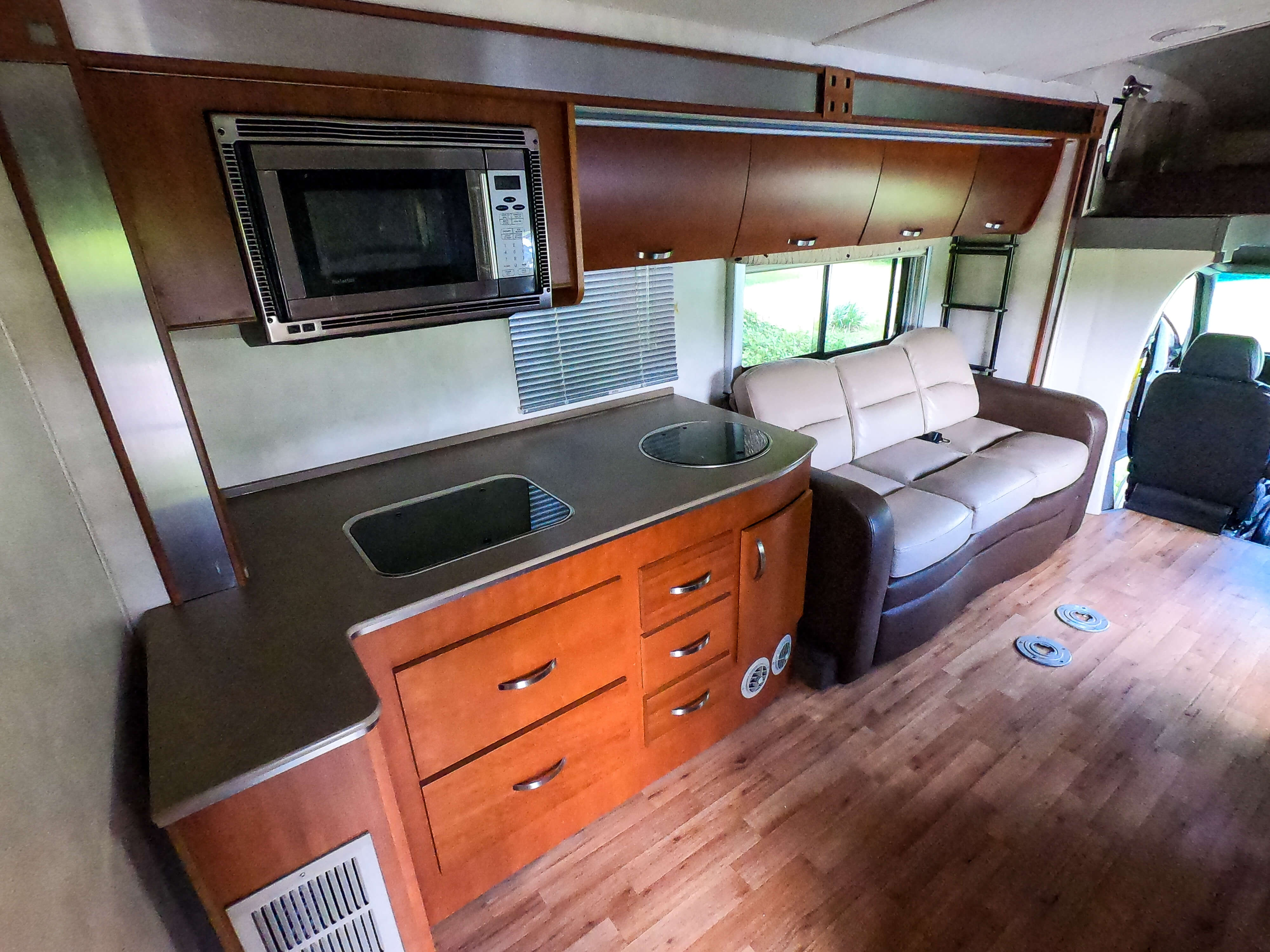 2010 Fleetwood Pulse 24S Kitchen and Living Room